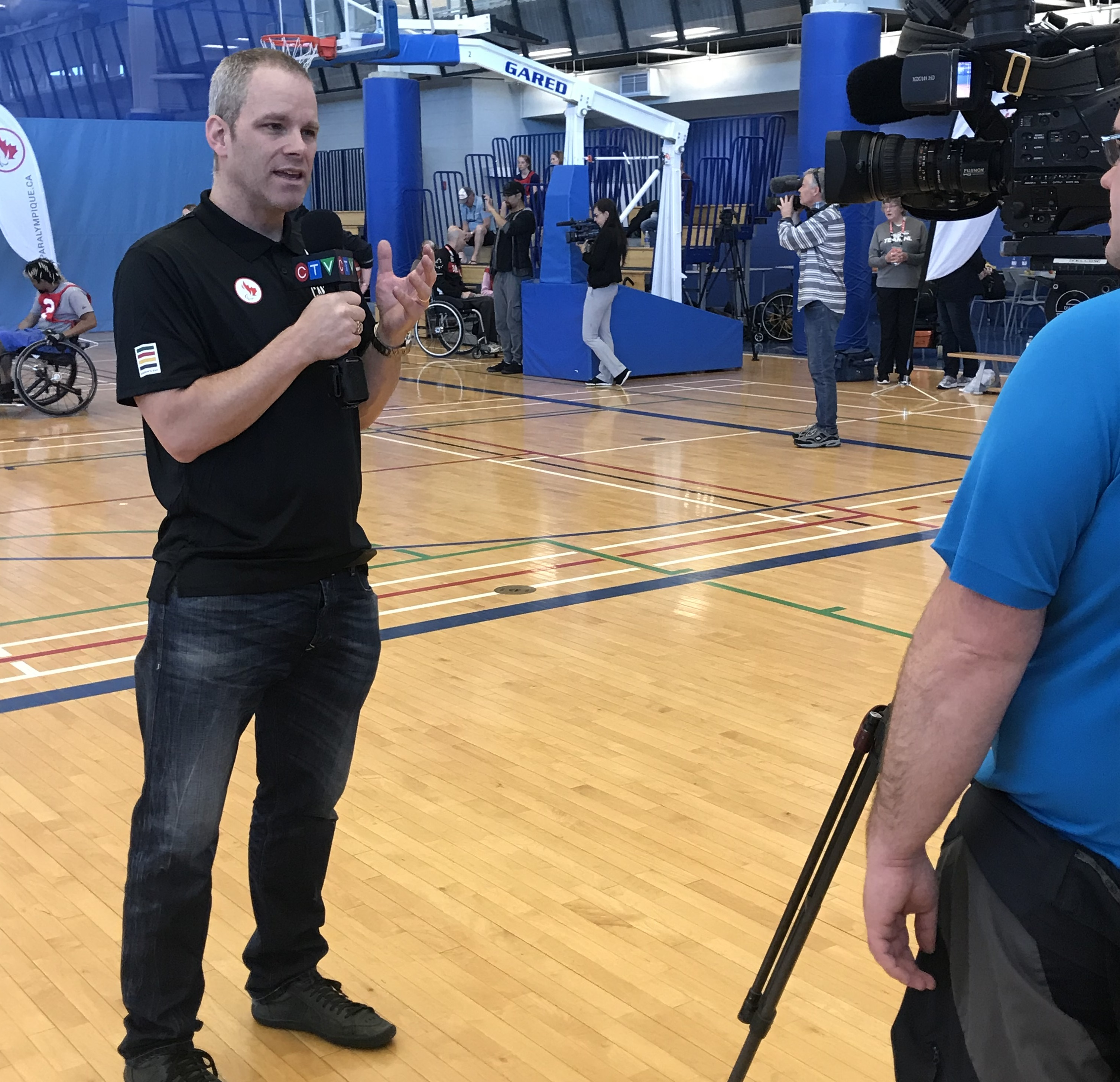 Andrew Haley doing a media interview with CTV at Paralympian Search in Halifax in 2019.