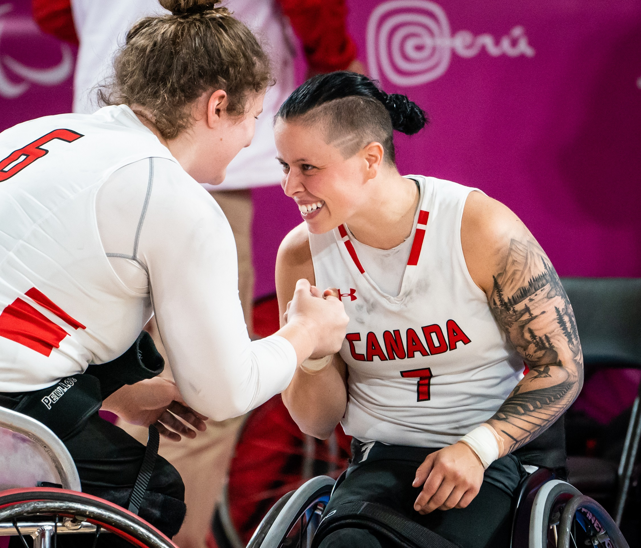 Cindy Ouellet and Arinn Young celebrate after winning the semifinals