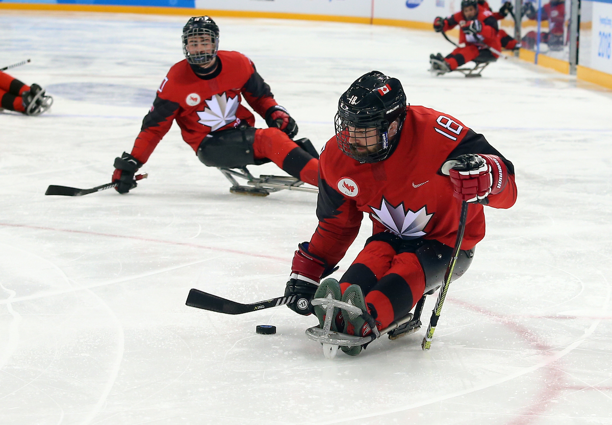 Billy Bridges with the puck in Para ice hockey competition at PyeongChang 2018,