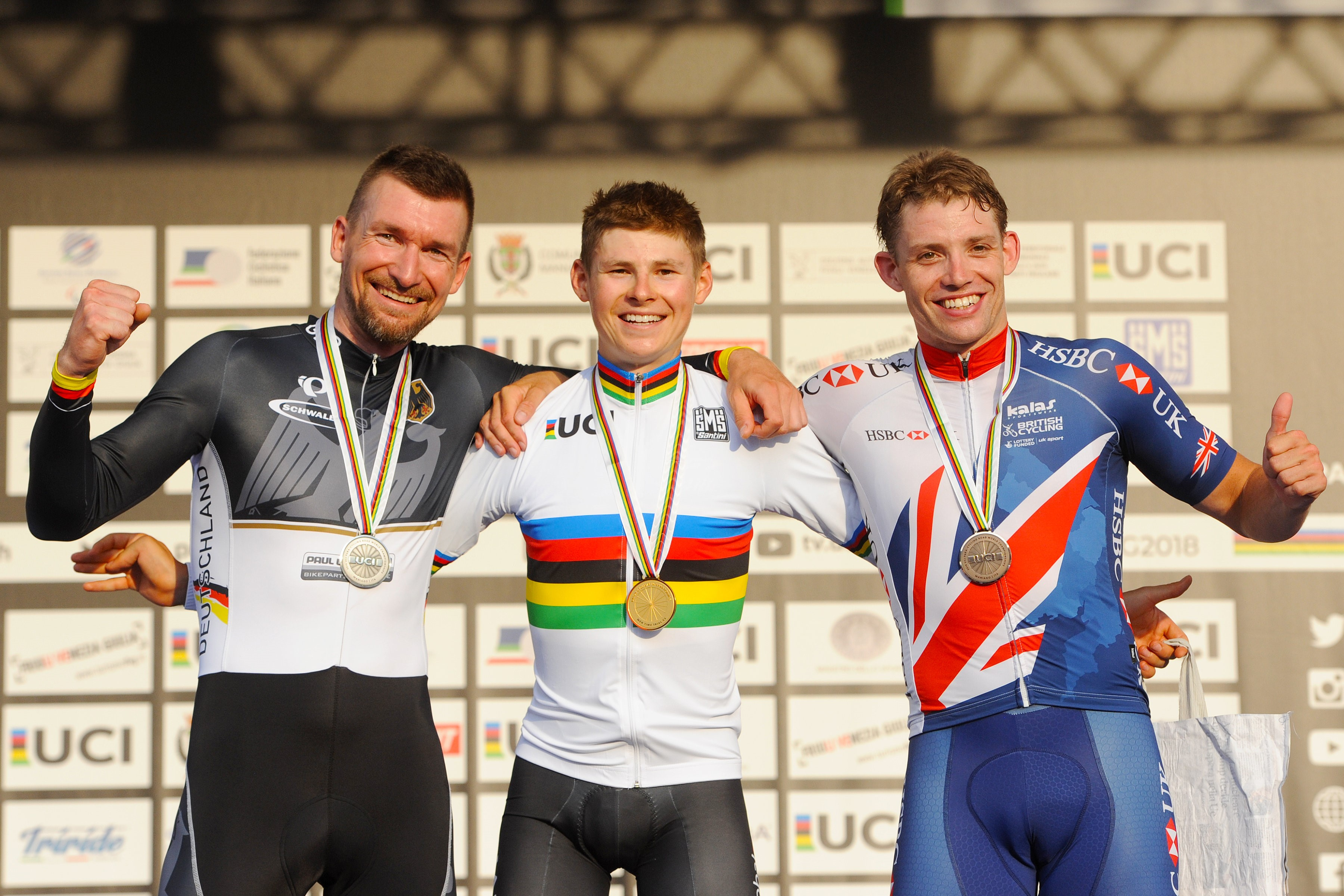 Michael Sametz (middle) after receiving his gold medal at the 2018 Para cycling road world championships