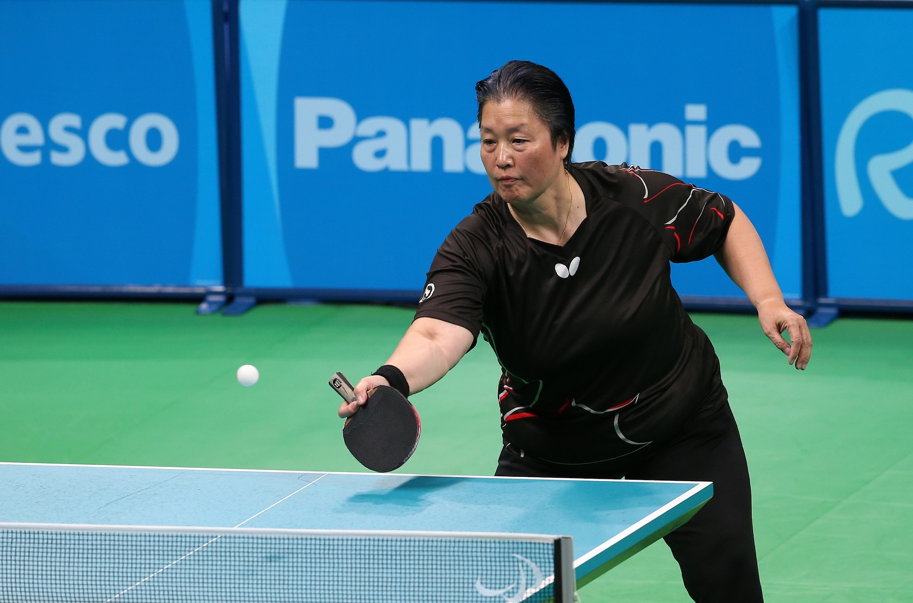 Five Para table tennis players...