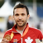 Guillaume Ouellet holding a gold medal
