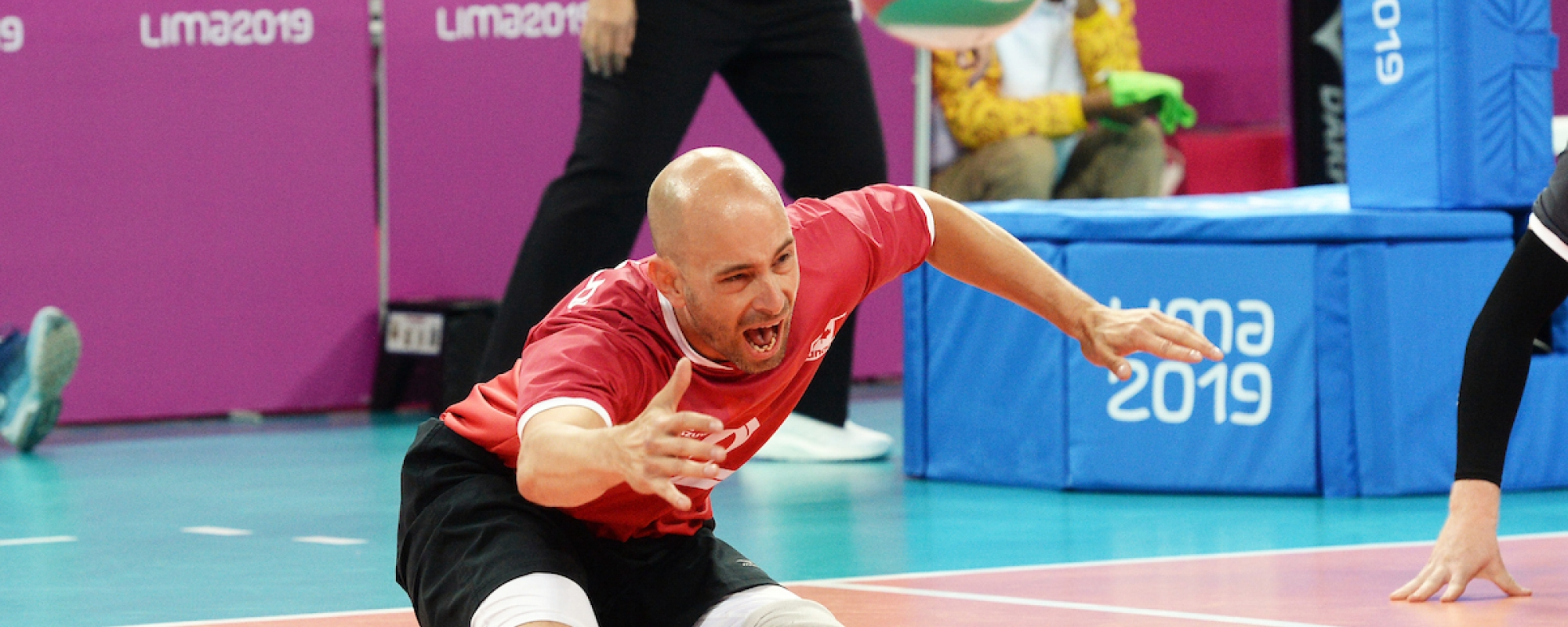 Mikael Bartholdy reaches for the ball in a game of sitting volleyball