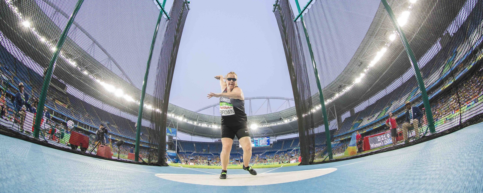 Jen Brown throwing a discuss in Rio from a fish lense camera showing the grandeur of the space