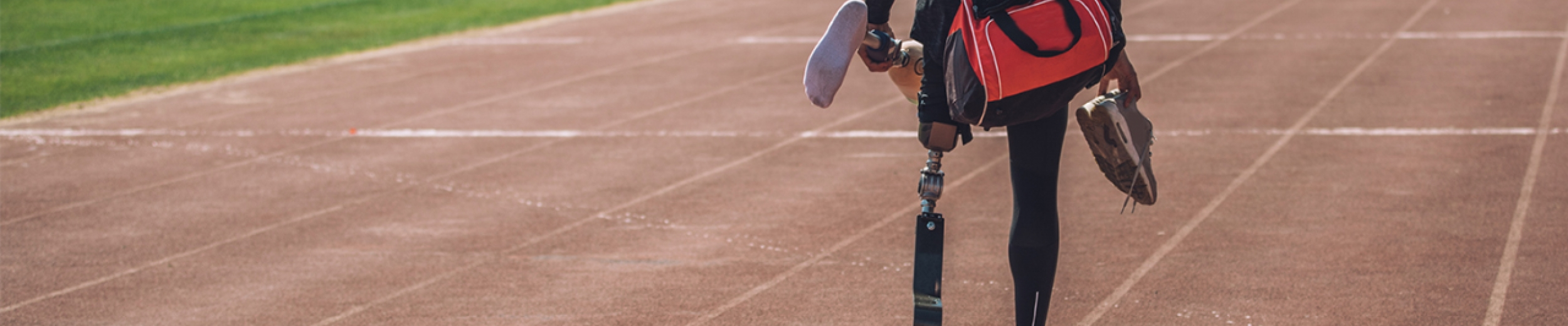 Athlete wearing a running blade carrying their prosthetic