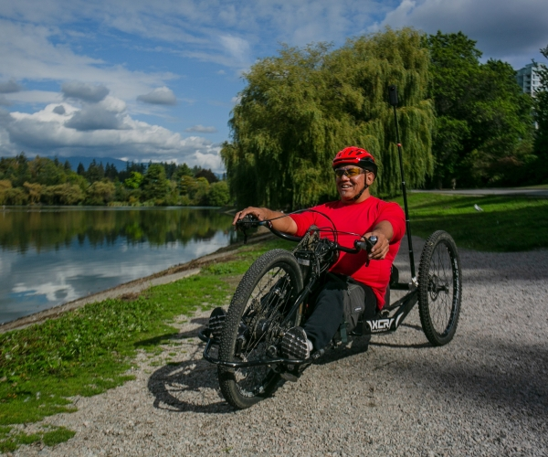 Richard Peter hand cycling in Stanley Park in Vancouver