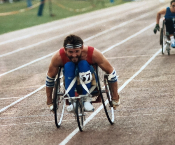 Paralympian Paul Clark competes in a wheelchair race.