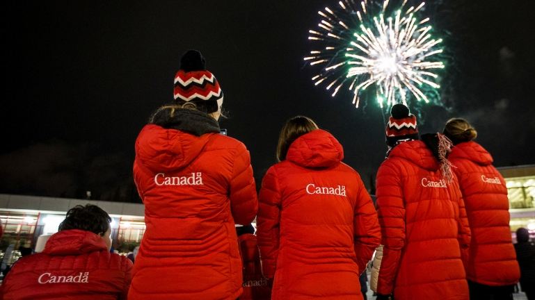 Canadian athletes watch fireworks at the 2019 World Para Nordic Skiing Championships Opening Ceremony.