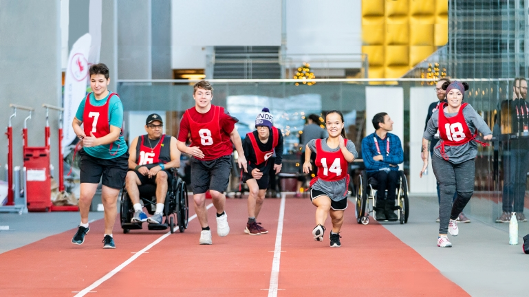 Athletes running at a Paralympian Search