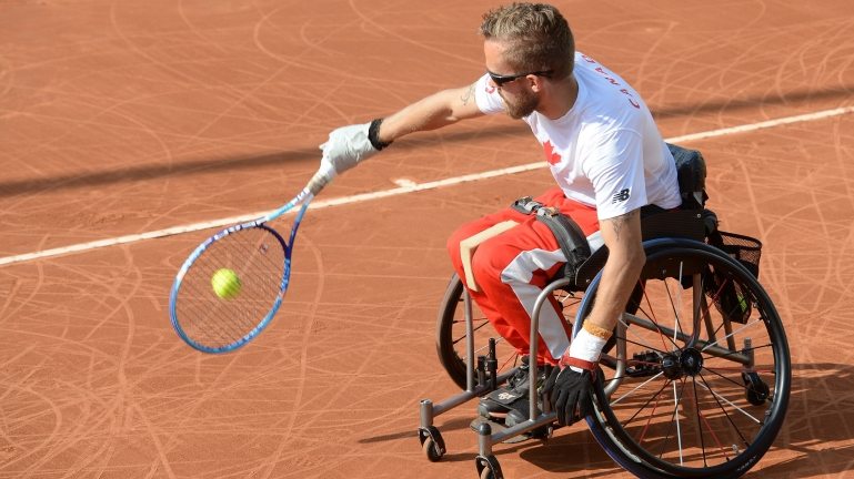 Rob Shaw hitting a backhand at the Lima 2019 Parapan Am Games.