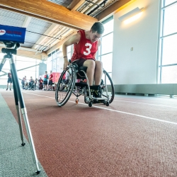 Paralympian Search participant racing in a wheelchair
