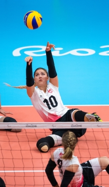 Jennifer playing sitting volleyball