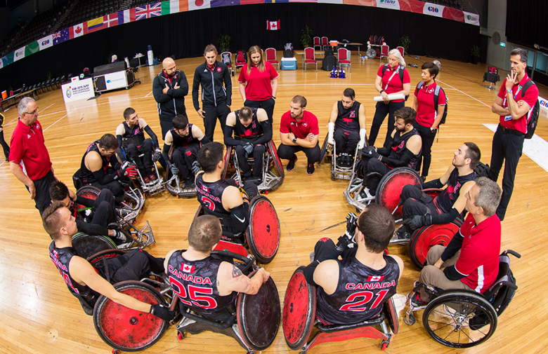 The Canadian wheelchair rugby team in a huddle at the 2018 world championships.