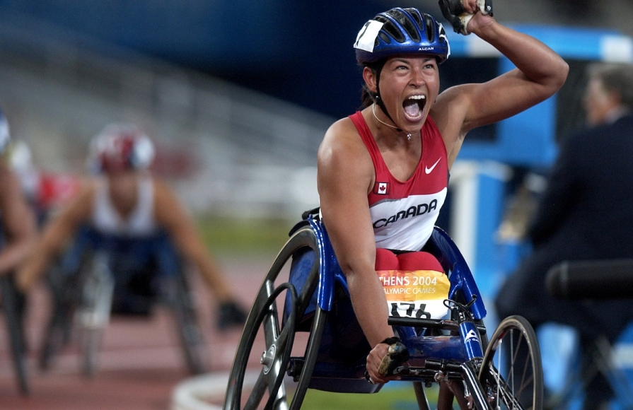 Chantal Petitclerc celebrates at the Athens 2004 Paralympic Games.