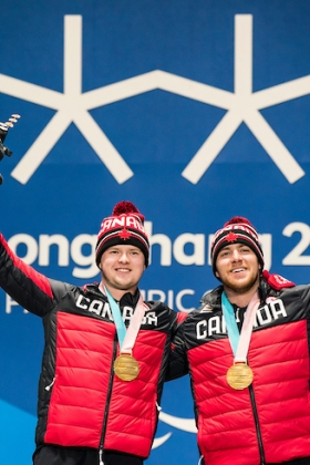 Mac Marcoux and his guide Jack Leitch collecting their gold medal in PyeongChang